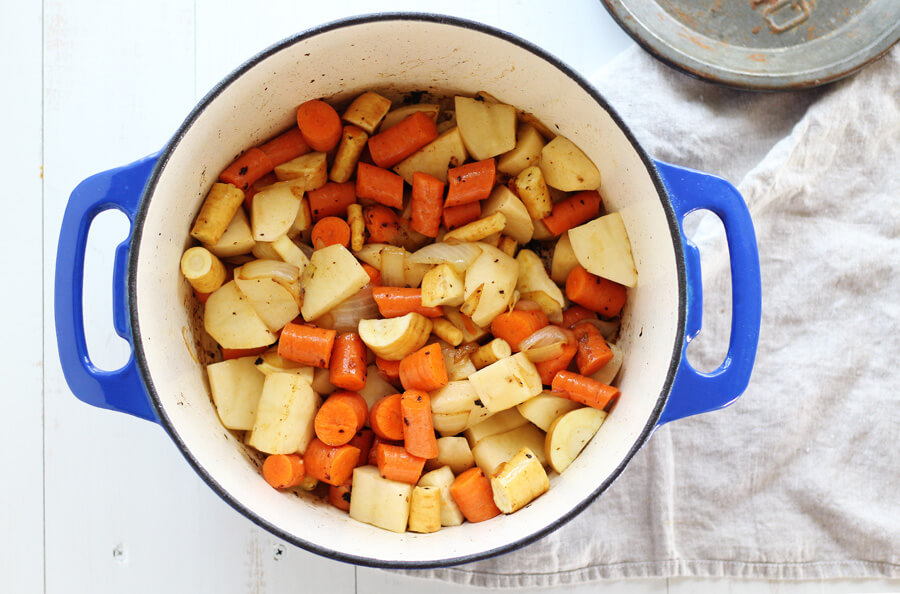 Parsnips, potatoes, carrots and onions simmering in butter.