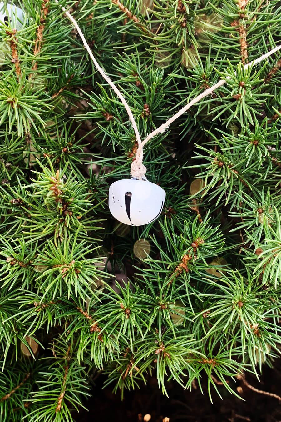 Jingle Bell Christmas Garland draped on an evergreen tree