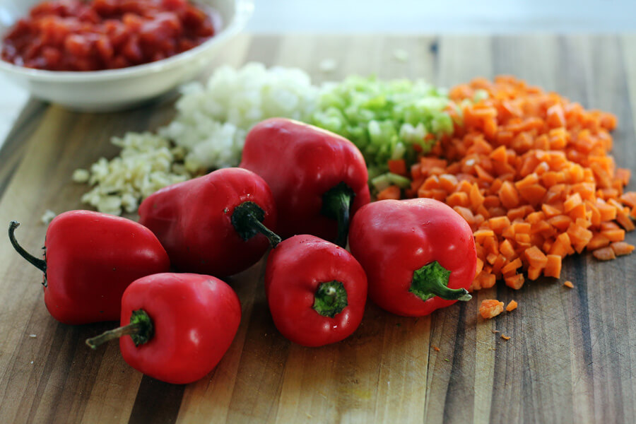 A cutting board with chopped, colorful vegetables for our homemade marinara sauce.