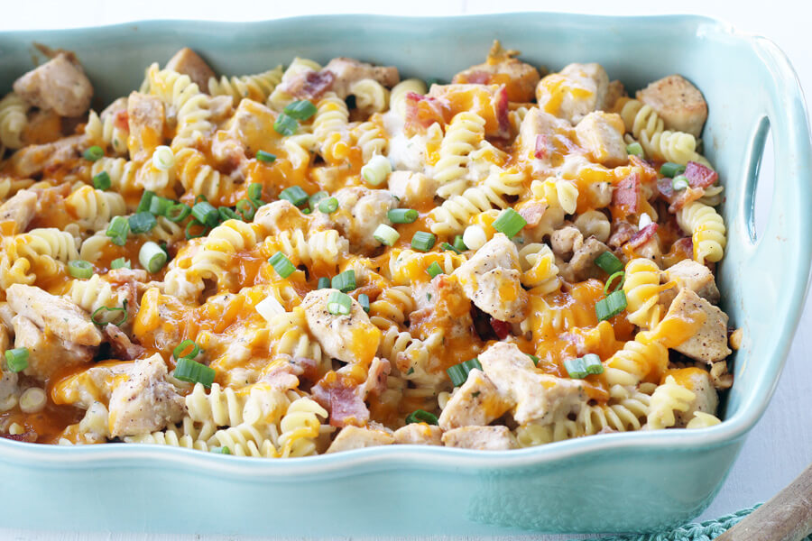 A casserole dish with cheesy pasta and chicken