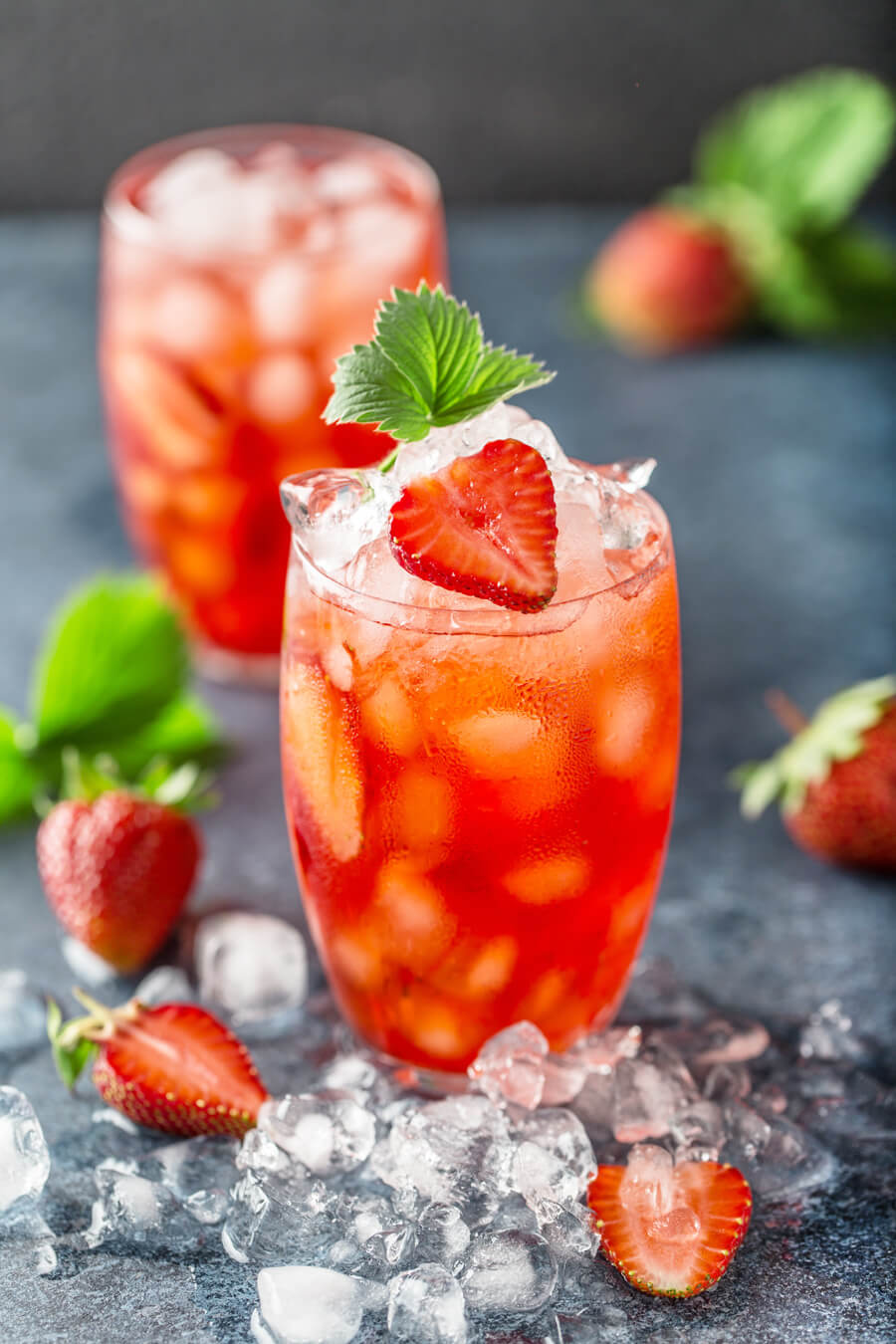 Light and refreshingly sweet with tart strawberries and a hint of mint, these Strawberry Mint Rum Cocktails are the perfect drink for the summer.  #rumcocktails #strawberrycocktails