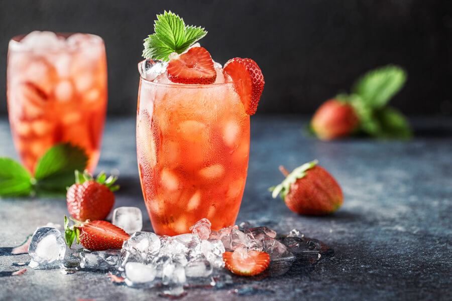 Made with fresh strawberries, sugar, lemon, and mint and mixed with club soda and light rum, this refresing strawberry cocktail will be a hit at your next party!    #rumcocktails #strawberrycocktails