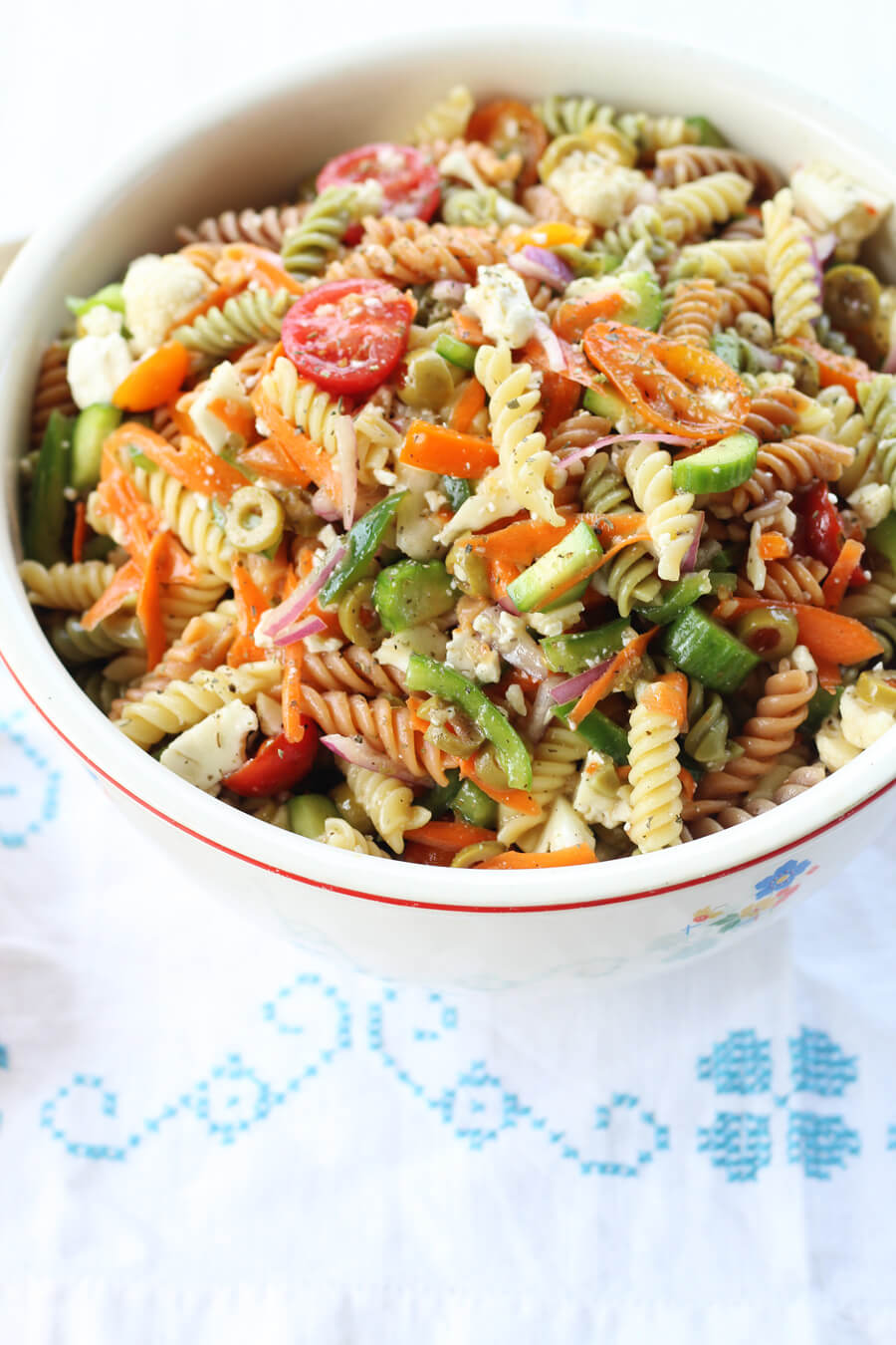 Zesty Italian Pasta Salad | Buy This Cook That  Get our delicious go-to recipe for Italian Pasta Salad. With colorful, healthy vegetables, a tangy dressing, and tri-color pasta, this side dish always pleases.   Easy to make ahead, too.   #Italianpastasalad #pastasalad