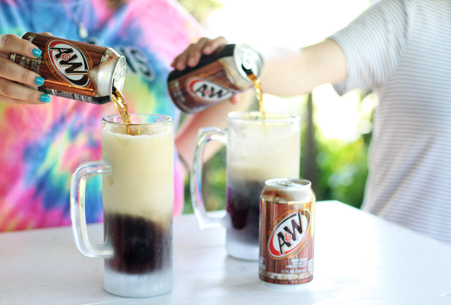 Two frosty mugs of A&W Root Beer.