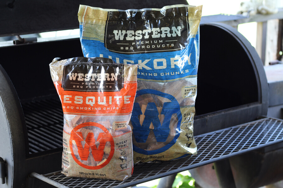 two bags of wood chips next to a charcoal grill