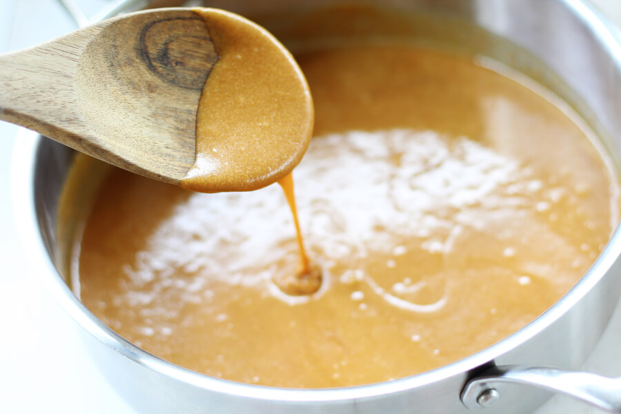 A sauce pan with melted peanut butter, brown sugar, and honey