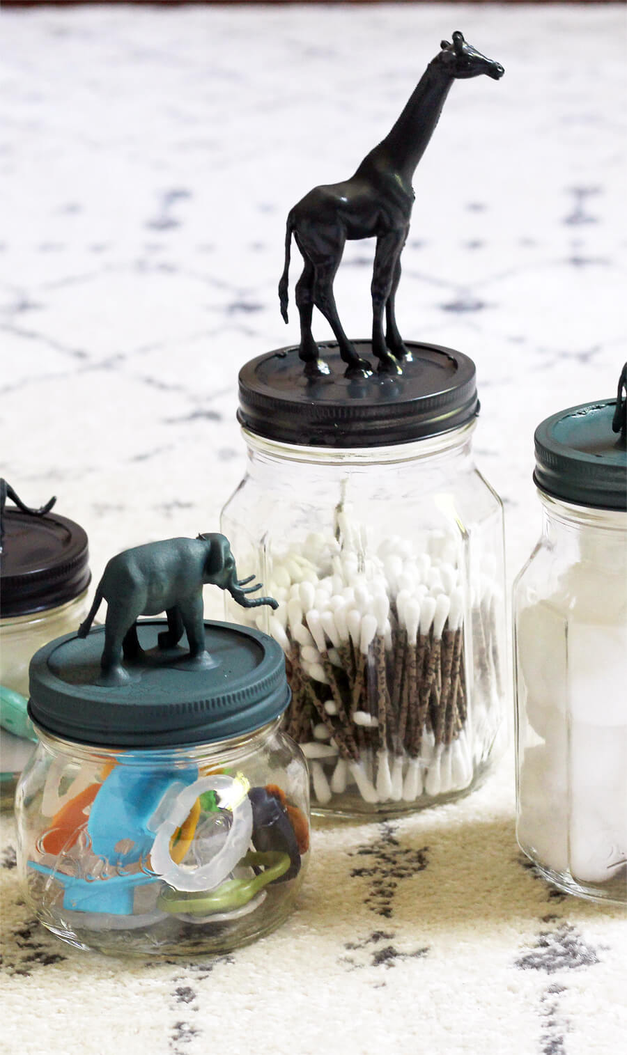 Need a cute and affordable way to add a little pizzazz to your baby's nursery on a budget?? These Safari Animal Mason jars are cute and functional.   #masonjars #safarianimals #babynurseryideas