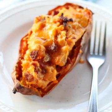 a sweet potato on a white plate