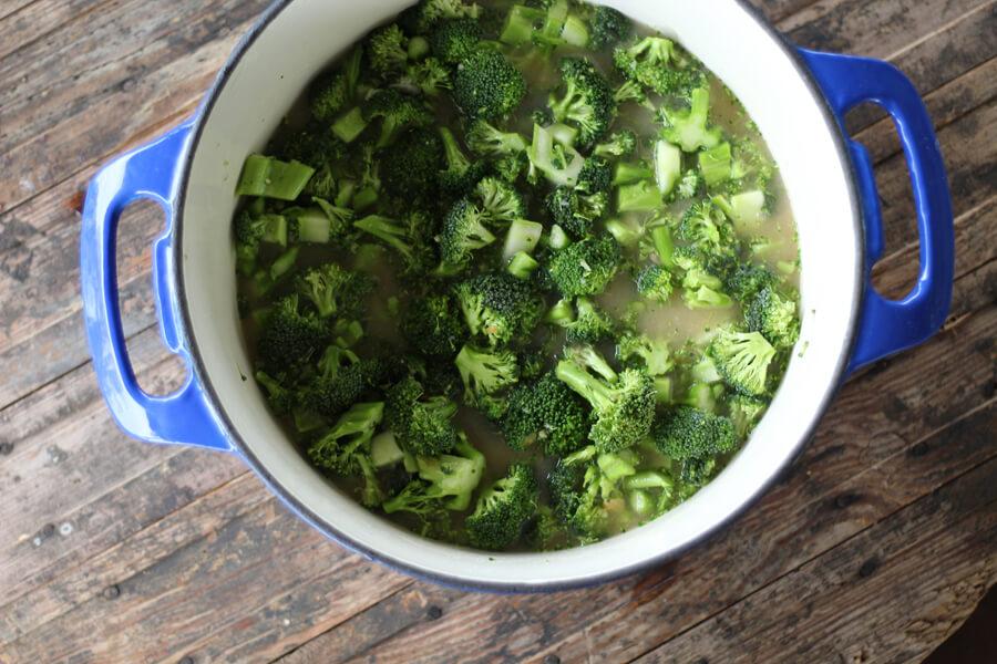 fresh chopped broccoli in a soup pot