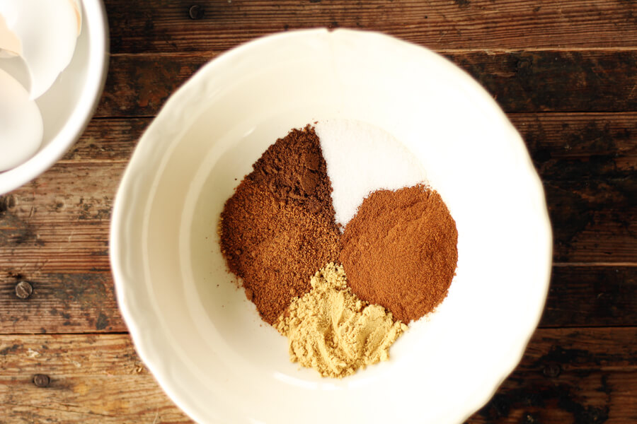 a small white bowl with cinnamon, nutmeg, ginger, and allspice