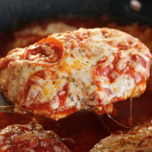 A chicken breast topped with marinara, mozzarella, and pepperoni