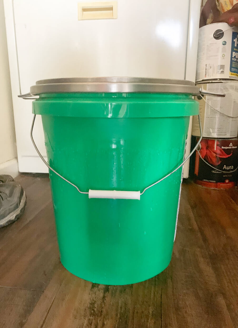 a green 5 gallon bucket