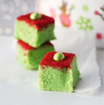 festive green and red white chocolate fudge with a seasonal holiday background with sparkling lights