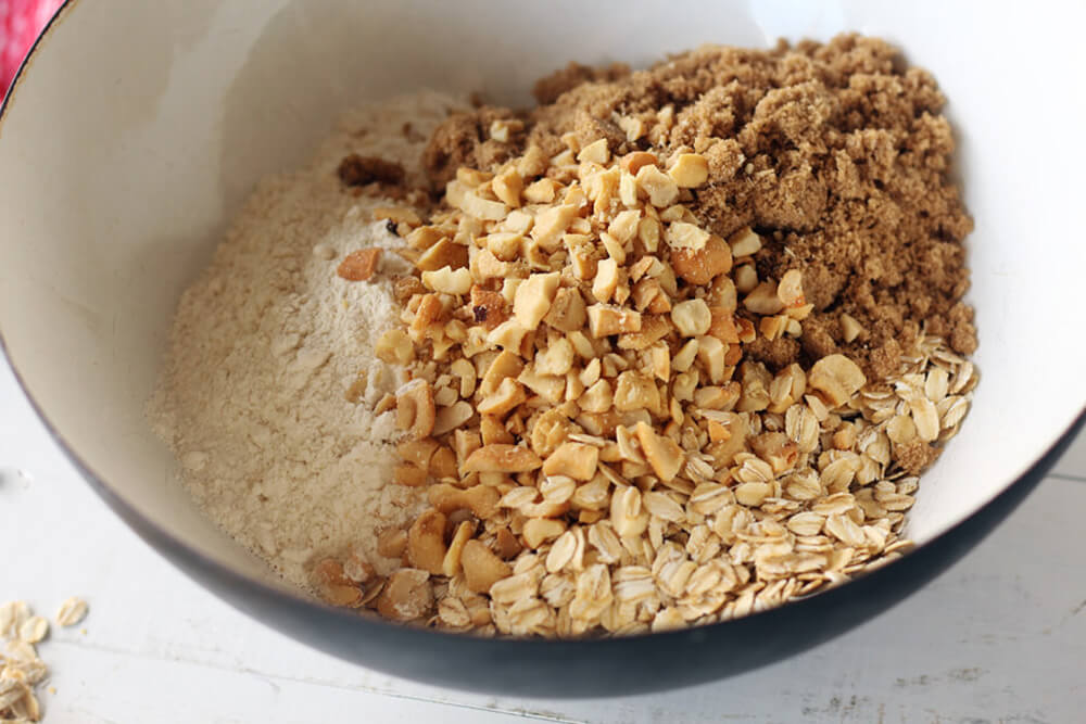 bowl of ingredients to make an oat and brown sugar crumb topping