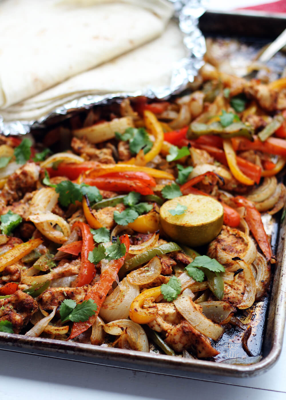 close up picture of chicken fajitas on a sheetpan
