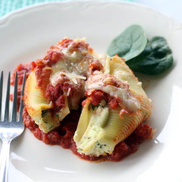 a plate of pasta shells stuffed with ricotta and spinach filling