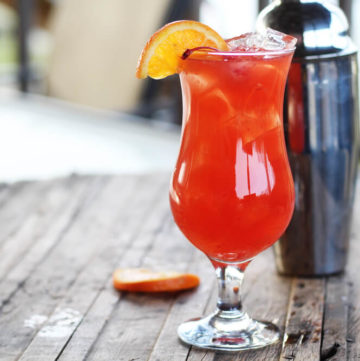 a fruity, tropical hurricane drink in a tall glass