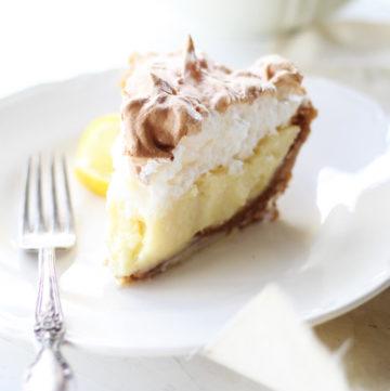 a slice of lemon pie on a white plate