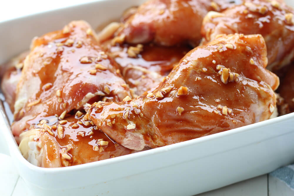 raw chicken in honey sriracha marinade