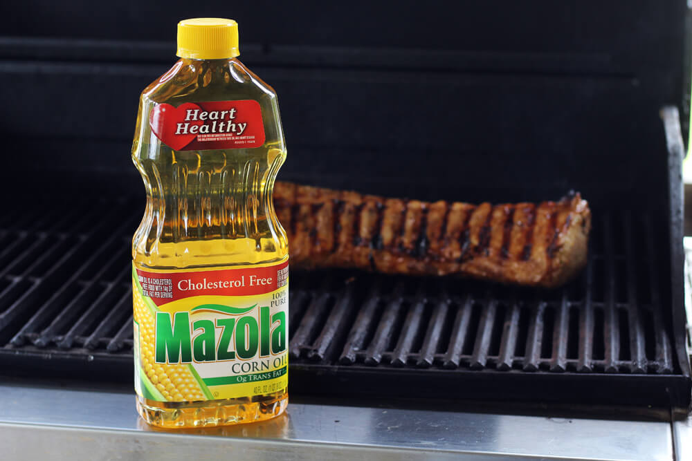 Mazola Corn Oil in front of a grill