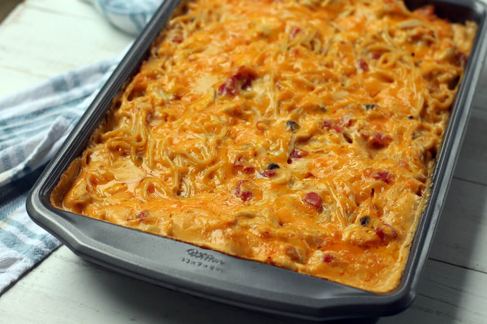 a baking pan of chicken spaghetti casserole