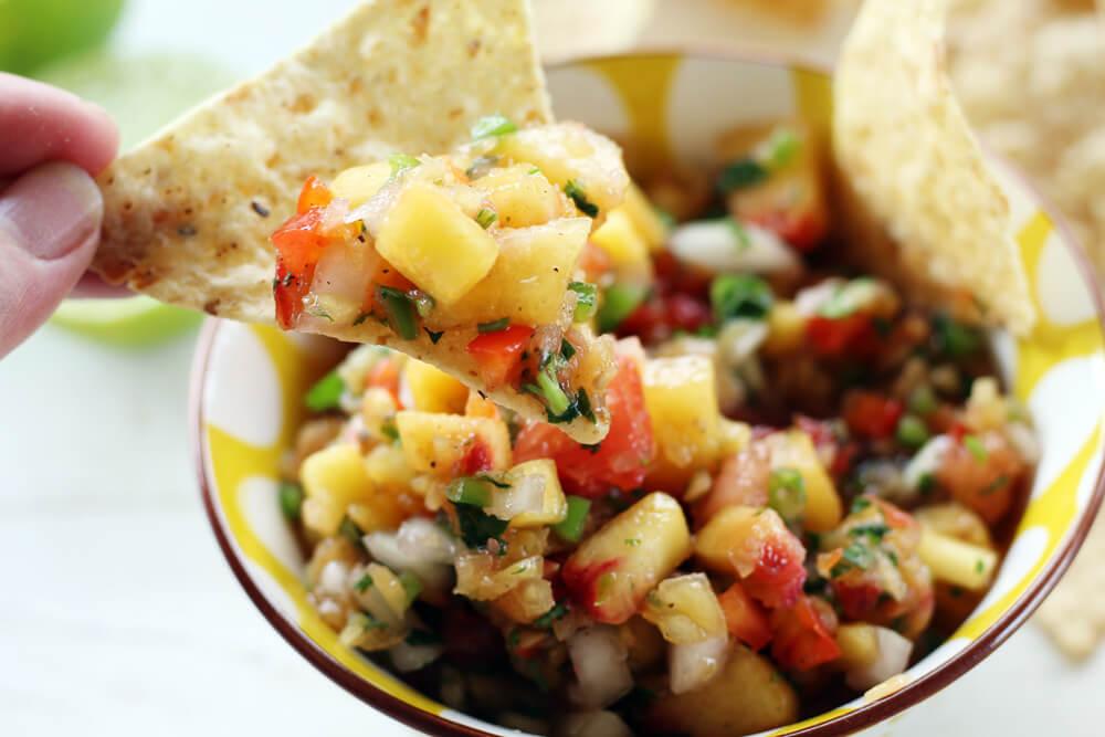 tortilla chip dipped into salsa