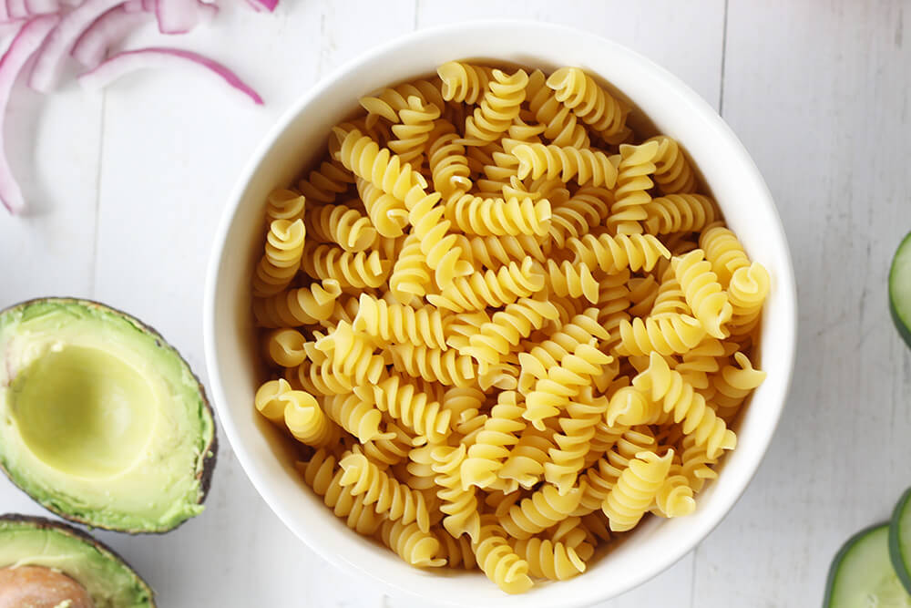 a bowl of rotini pasta