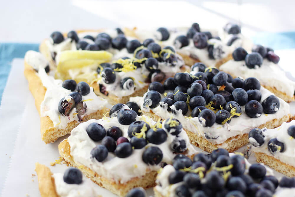dessert pizza with cheesecake fluff and fresh blueberries