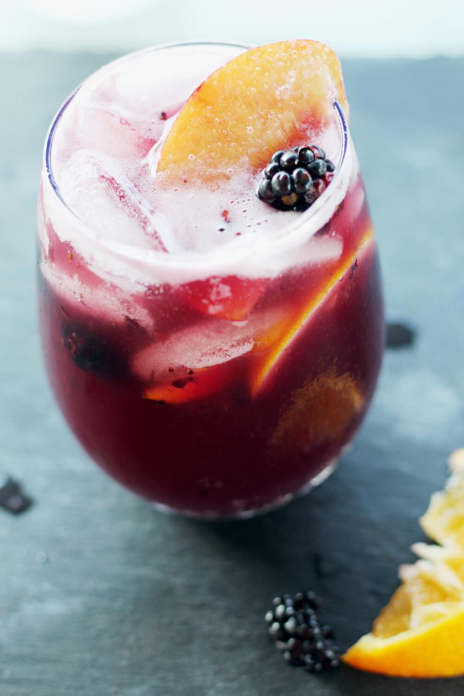 A glass of peach sangria