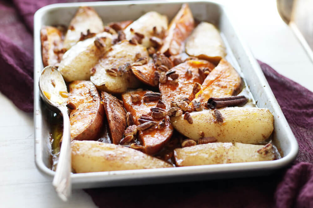 pears and sweet potatoes on a baking pan