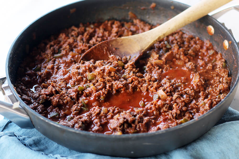 a skillet of sauce and ground beef