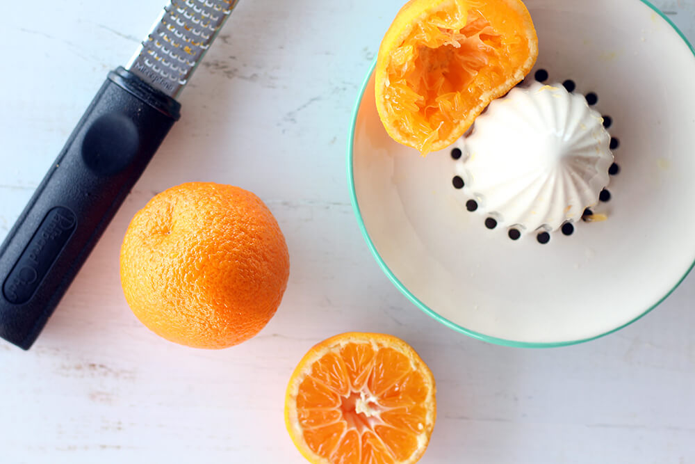 mandarin oranges being zested and juiced