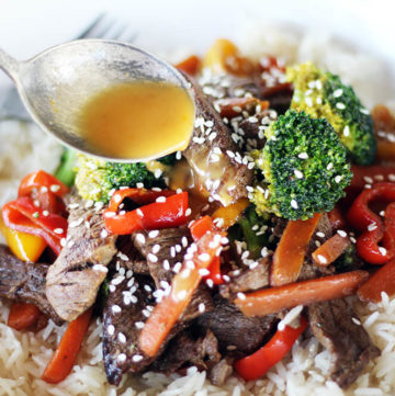 citrus dressing spooned over beef and vegetables