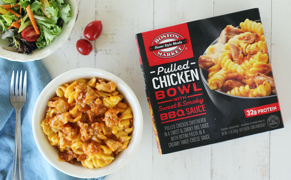 overhead picture of pasta and chicken in a bowl next to a frozen meal box