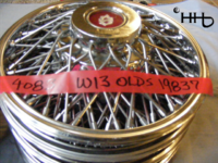 A stack view of hubcap # w13olds1983_7