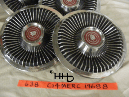 Close up view of group of hubcaps # c14merc1968_8