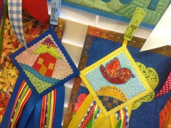 Rosettes inspired by Laura Wasilowski book Fanciful Stitches Colorful Quilts