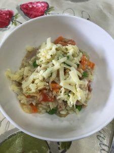 Buzymum - Finished bacon and monkfish risotto sprinkled with cheese