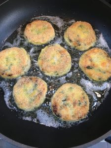 Buzymum - Salmon fishcakes shallow frying on their second side