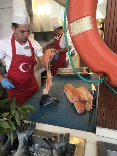 Buzymum - Chefs at Liberty Lykia, preparing fresh fish