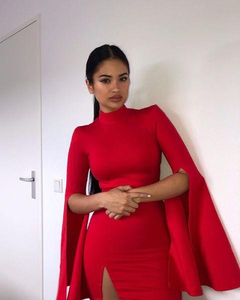 Joy'nae Elisah Bowier in red dress