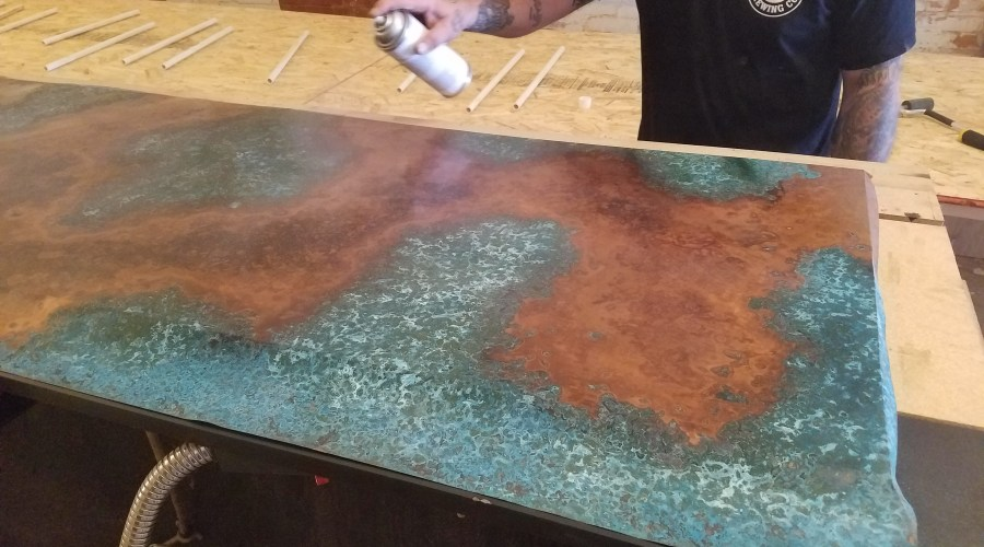 Varnishing copper top