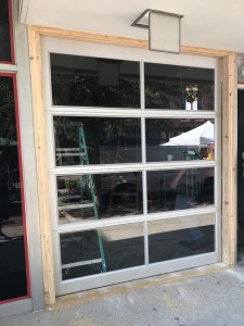 new glass roller door