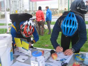 Riders fill out entry forms for the commuter station prize draw.
