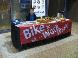 Paul Cheng from TransLink, watching over the treats at the Bike to Work Week commuter station in Metrotower II.