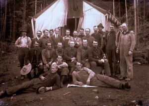 A very rare image of labourers at a streetcar work camp, standing and sitting in three rows in front of a large tent.  The photo is taken by early Burnaby photographer J.W. Phillips, and dated between 1910 and 1914 --- it's a brand new addition to the City of Burnaby collection, as Phillips' collection of glass plate negatives was discovered in a private residence by a Burnaby staff member. (Item 487-011, from the J.W. Phillips fonds, courtesy of the City of Burnaby Archives.)