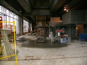 The concrete block walls at right are built to house the electrical and elevator rooms in the station.