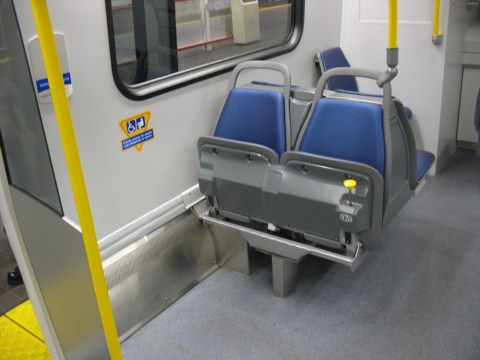 These seats on the train fold up to allow room for wheelchairs and strollers.