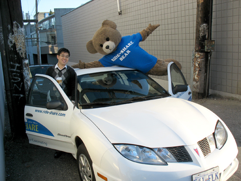 The Ride-Share bear with a ridesharing buddy in one of the Jack Bell Ride-Share cars! (They provide cars for your carpool, free!)
