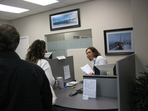 A customer being helped at the Quickpass counter.